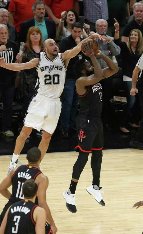 San Antonio Spurs' Manu Ginobili blocks Houston Rockets' James Harden at the end of overtime in the Western Conference semifinals at the AT&T Center, Tuesday, May 9, 2017. The Spurs won in overtime 110-107 to go up in the series, 3-2. Photo: JERRY LARA / San Antonio Express-News / © 2017 San Antonio Express-News