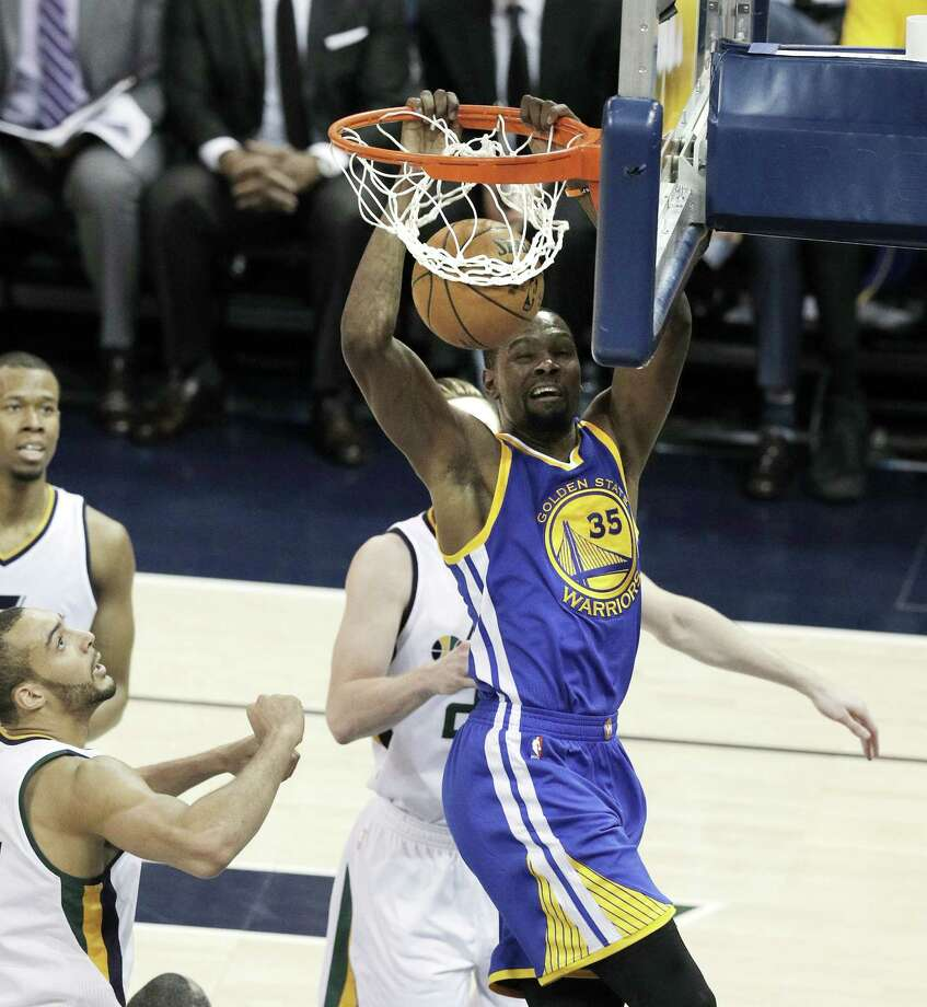 Kevin Durant (35) dunks in the first half as the Golden State Warriors played the Utah Jazz at Vivint Smart Home Arena in Salt Lake City, Utah, on Monday, May 8, 2017, in Game 4 of the 2017 Western Conference Semifinals. The Photo: Carlos Avila Gonzalez, Staff / ONLINE_YES