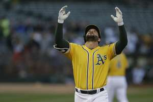Oakland Athletics' Yonder Alonso celebrates after hitting a two run home run off Los Angeles Angels' Alex Meyer in the first inning of a baseball game, Tuesday, May 9, 2017, in Oakland, Calif. (AP Photo/Ben Margot)