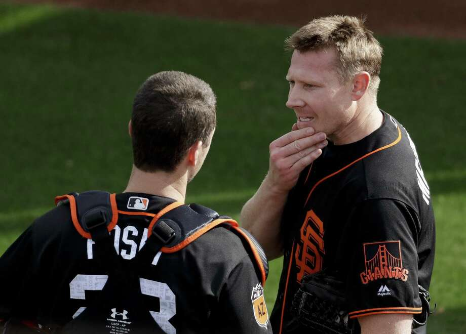 San Francisco Giants relief pitcher Mark Melancon, right, talks to catcher Buster Posey during spring baseball practice in Scottsdale, Ariz., Tuesday, Feb. 14, 2017. (AP Photo/Chris Carlson) Photo: Chris Carlson / AP / Copyright 2017 The Associated Press. All rights reserved.