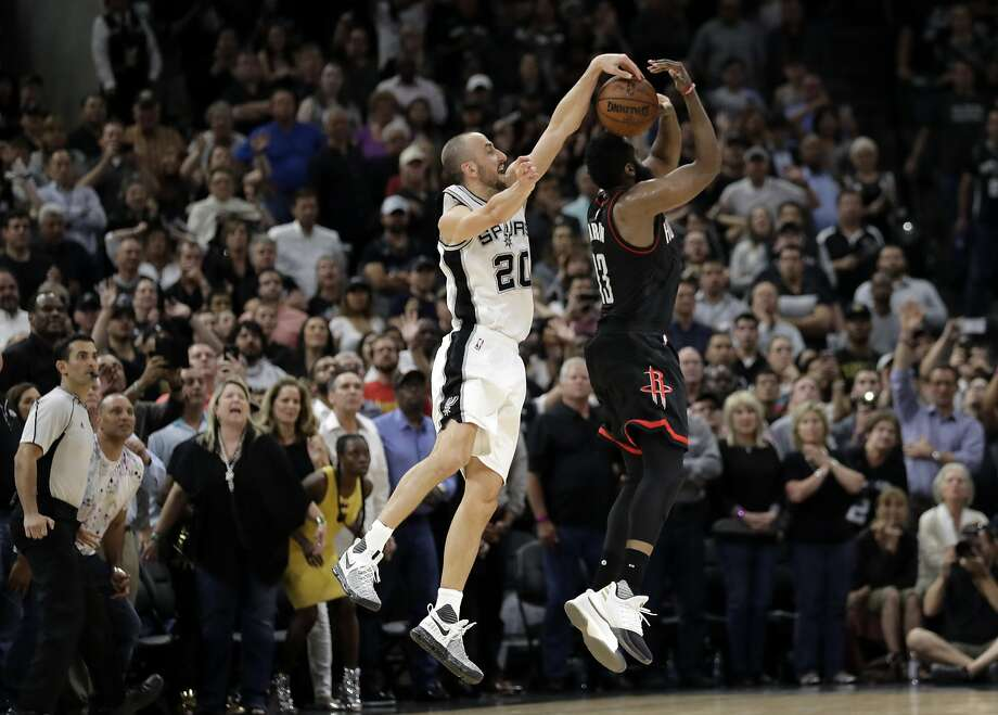 San Antonio Spurs' Manu Ginobili (20) of Argentina blocks Houston Rockets' James Harden three-point shot attempt in the final seconds of overtime of Game 5 in a second-round NBA basketball playoff series, Tuesday, May 9, 2017, in San Antonio. San Antonio won 110-107. (AP Photo/Eric Gay) Photo: Eric Gay, Associated Press