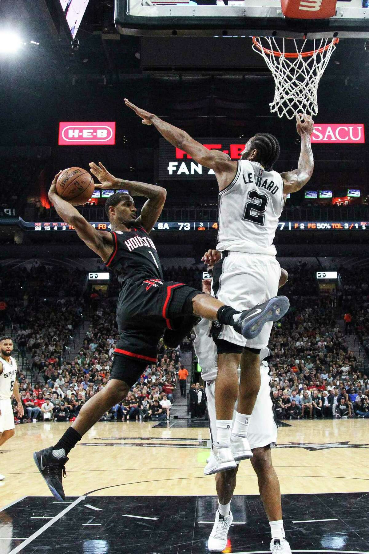 San Antonio Spurs forward Kawhi Leonard (2) jumps up to block Houston Rockets forward Trevor Ariza (1) during overtime of Game 5 of the second round of the Western Conference NBA playoffs at AT&T Center, Tuesday, May 9, 2017, in San Antonio.