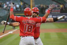 OAKLAND, CA - MAY 09:  Albert Pujols #5 and Luis Valbuena #18 of the Los Angeles Angels of Anaheim celebrates after Pujols hit a solo home run against the Oakland Athletics in the top of the first inning at Oakland Alameda Coliseum on May 9, 2017 in Oakland, California.  (Photo by Thearon W. Henderson/Getty Images)