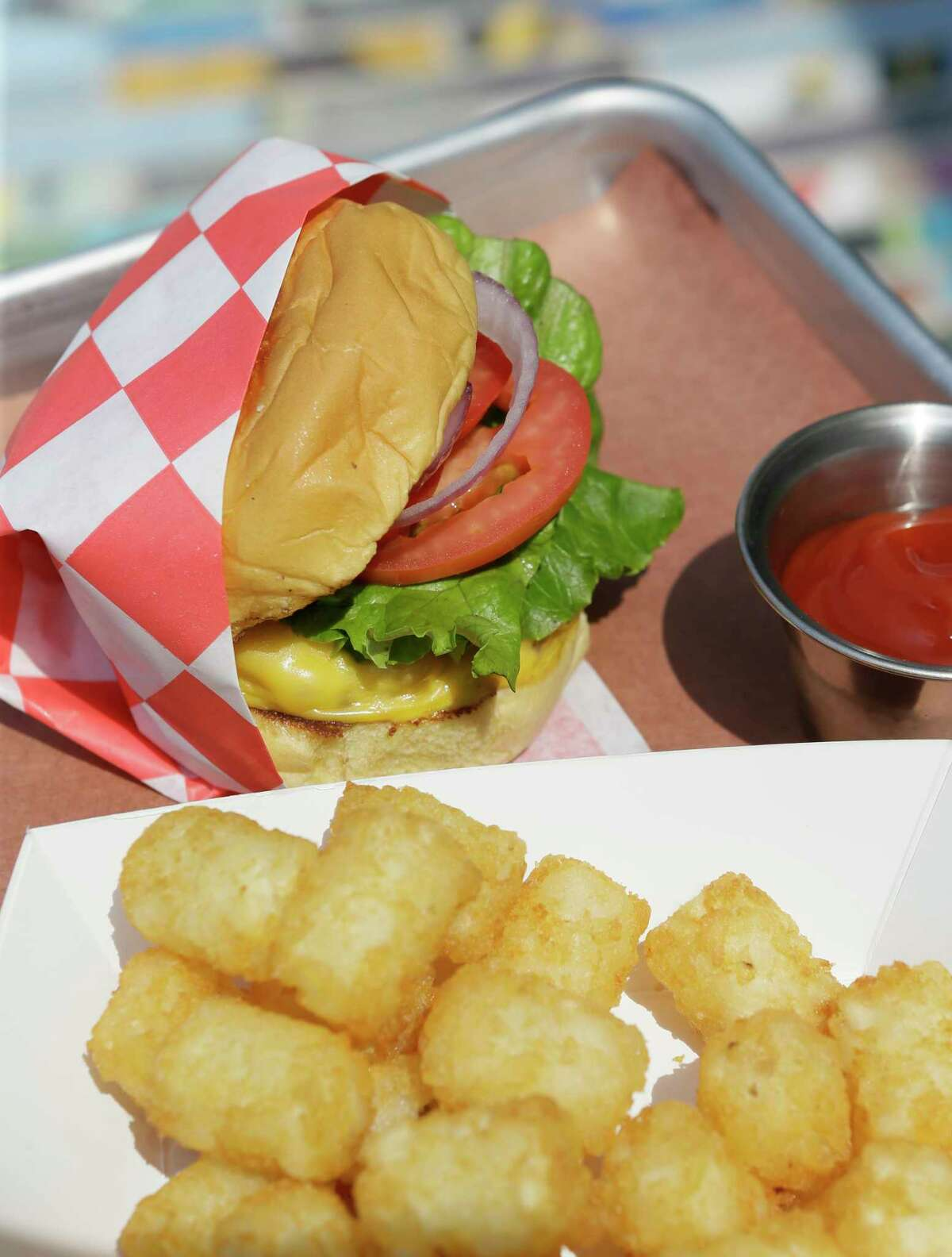 An FM Burger with tots is shown at FM Kitchen and Bar, 1112 Shepherd.