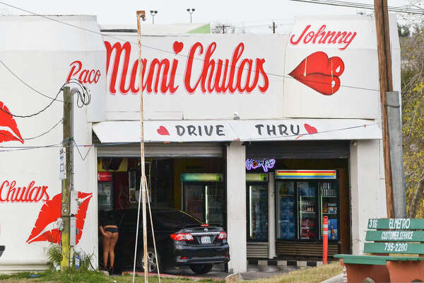 An outside view of the Mami Chulas beer run on the corner of Santa Clara and Zapata Highway, shows one of the workers taking an order from a customer, Tuesday afternoon.