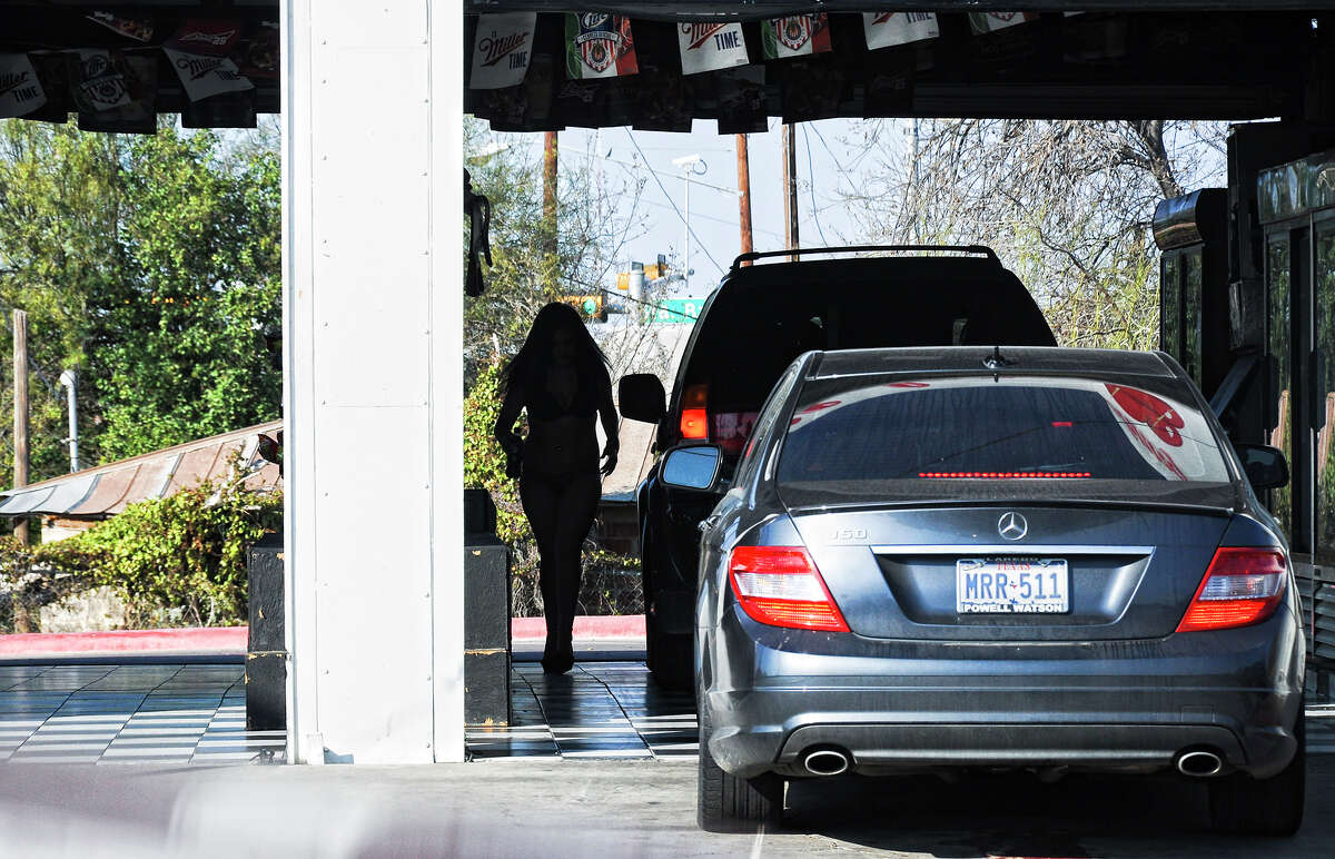 Mami Chulas drive thru waitress attends several vehicles in this file photo.