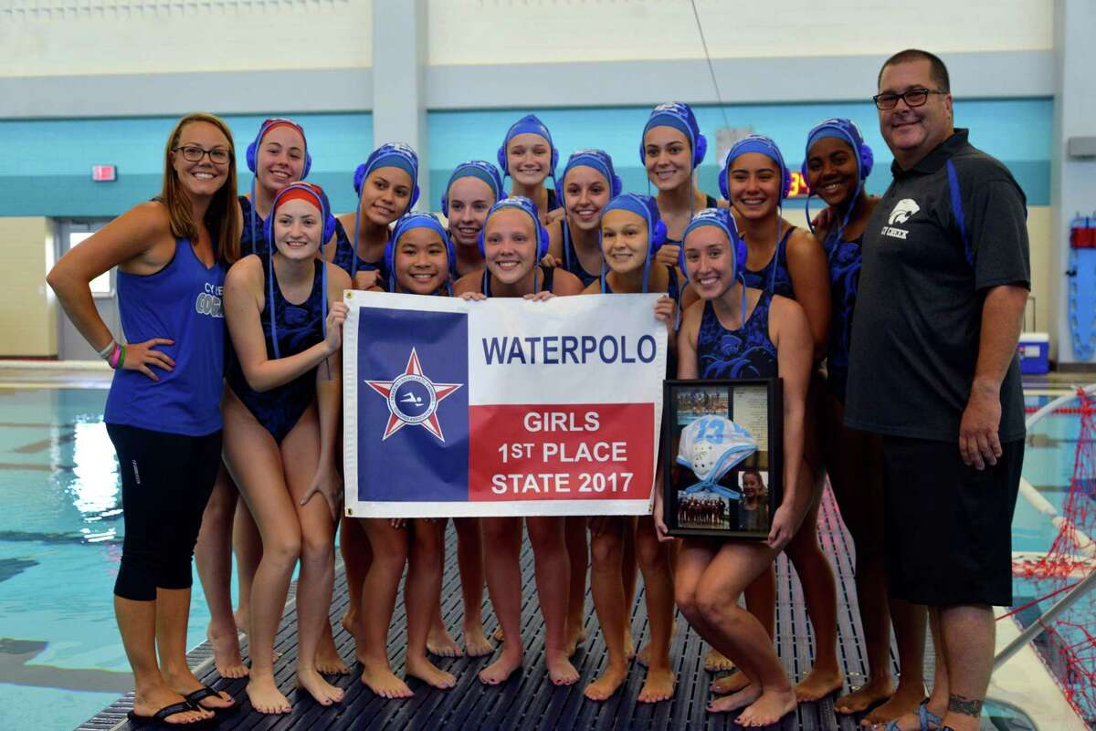 The Cy Creek Girls Water Polo squad holds a banner commemorating the 2017 state title. With a 10-6 win against St. Agnes in the State Finals, the Cougars notched a second-consecutive title, earning head coach Jeff Chandler a second-straight Coach of the Year big. The Cougars graduate three seniors, including the 2016 State MVP Sydney Coachman, but look poised to continue rolling next year with a promising crop of juniors and underclassmen ready to step up.