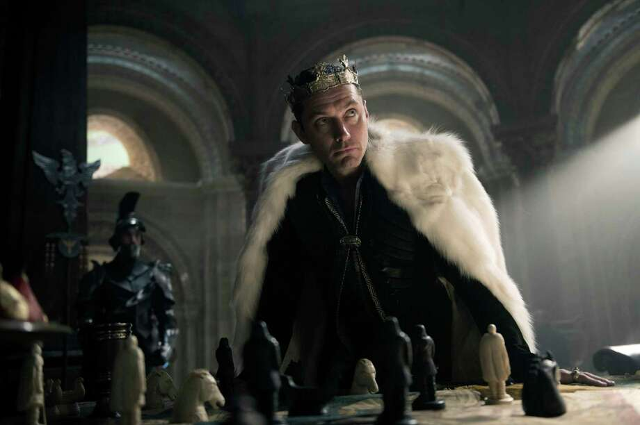 """This image released by Warner Bros. Pictures shows Jude Law in a scene from, """"King Arthur: Legend of the Sword."""" (Daniel Smith/Warner Bros. Pictures via AP) Photo: Daniel Smith, HONS / © 2016 Warner Bros. Entertainment"""
