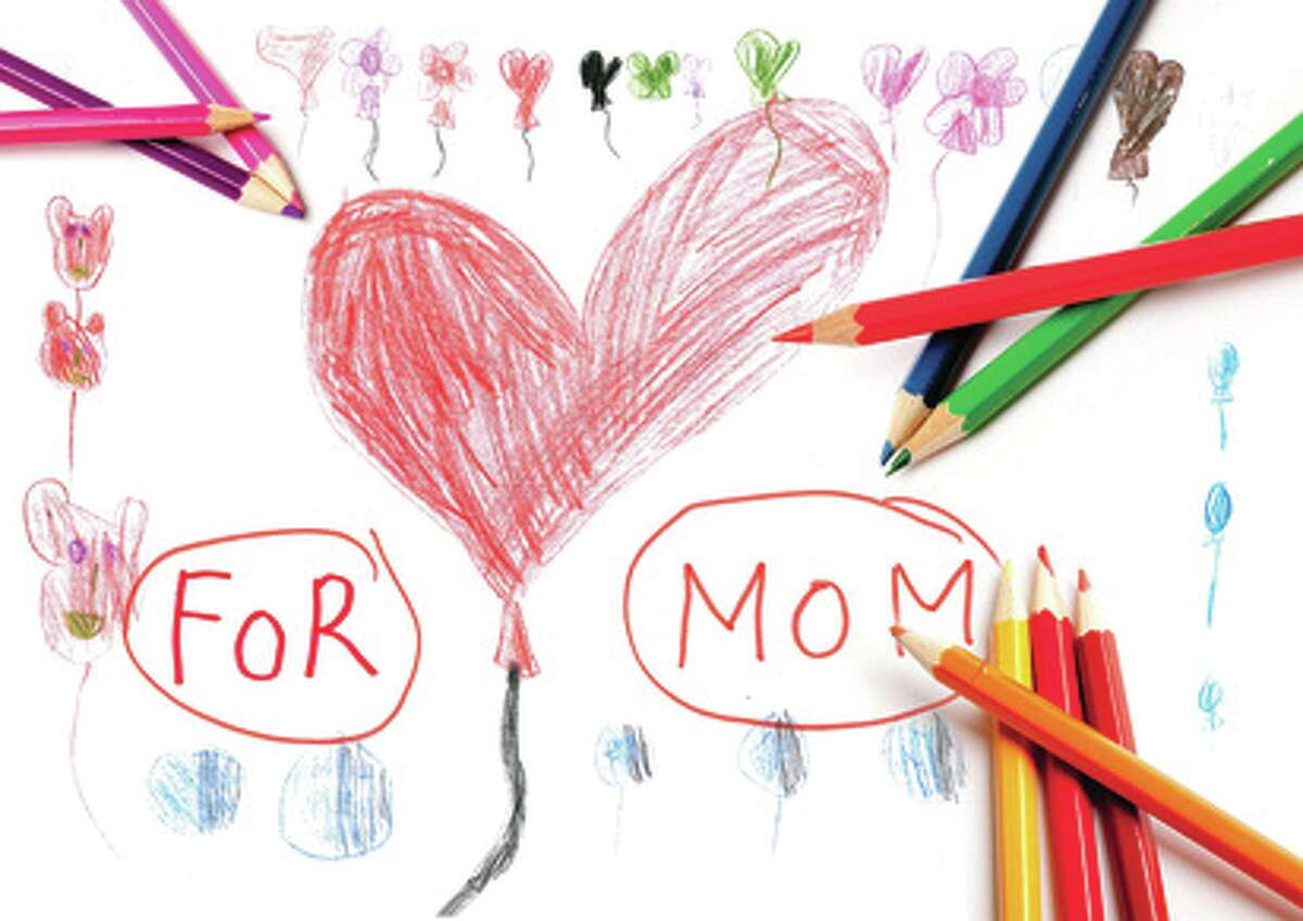 Mother's day drawing and coloring pencils of a child