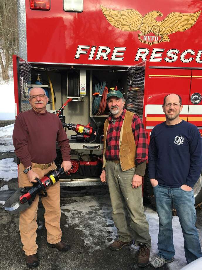 The Northville Volunteer Fire Department has received a grant from the Ellen Knowles Harcourt Foundation for the purchase of vehicle extrication equipment. Fire Chief Alan Harris, left, joins Bob Nicholas of the foundation, middle, and grant writer John Kuck. Photo: Courtesy Of Northville Volunteer Fire Department / The News-Times Contributed
