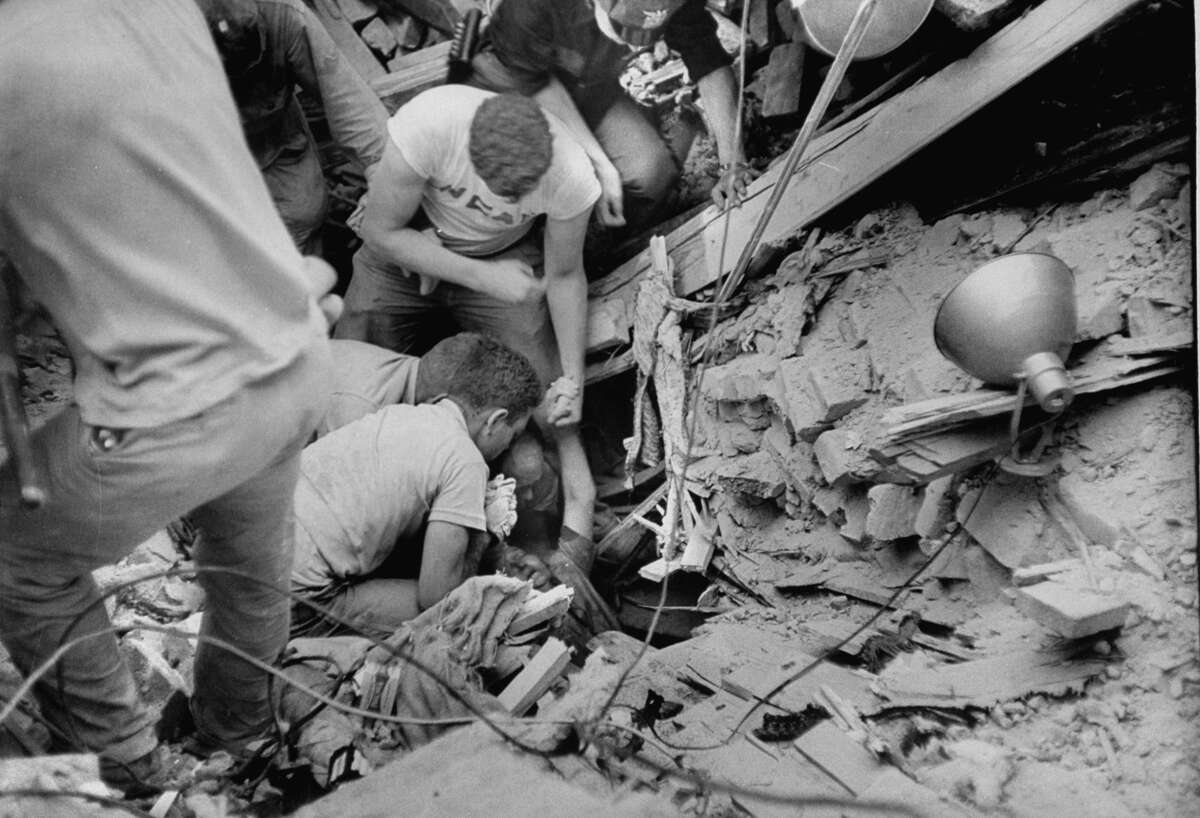 Workmen searching the wreckage of the Waco tornado for survivors.