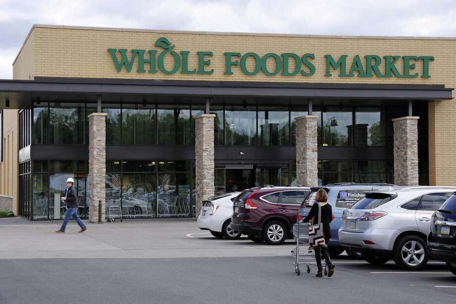 Sales at Whole Foods have dropped for six straight quarters, with analysts predicting the company will post another decline. The company is trying to shed its reputation for being overpriced and draw in new customers by controlling costs and pushing discounts. Photo: Gene J. Puskar /Associated Press / Copyright 2017 The Associated Press. All rights reserved.