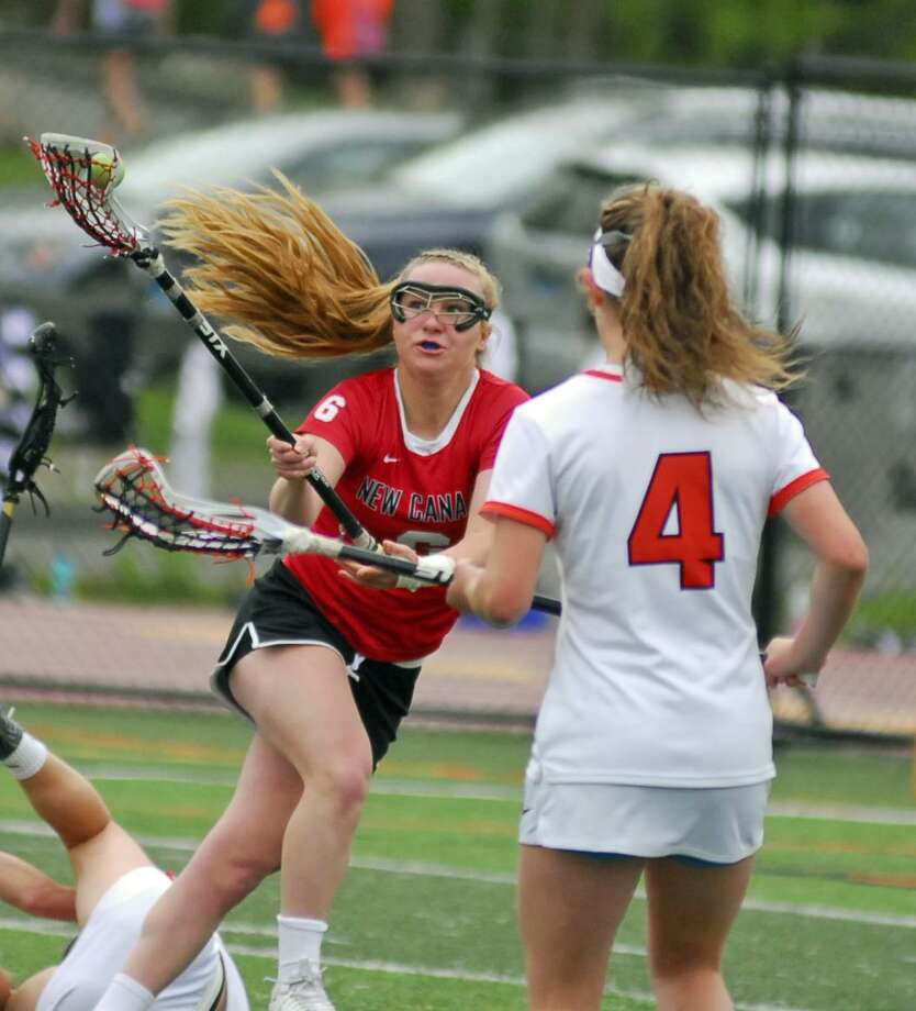 Action from New Canaan's 16-10 win over Ridgefield on Tuesday. Photo: Ryan Lacey / Hearst Connecticut Media