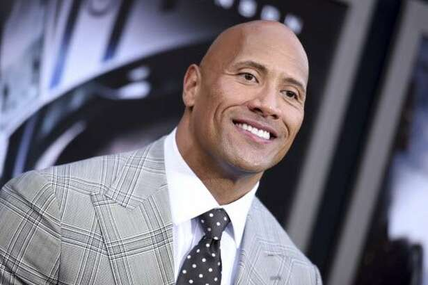 """FILE - In this May 26, 2015, file photo, Dwayne Johnson arrives at the premiere of """"San Andreas"""" at the TCL Chinese Theatre in Los Angeles. Johnson told GQ for a story published May 10, 2017, that he is seriously considering a run for president. (Photo by Richard Shotwell/Invision/AP, File)"""