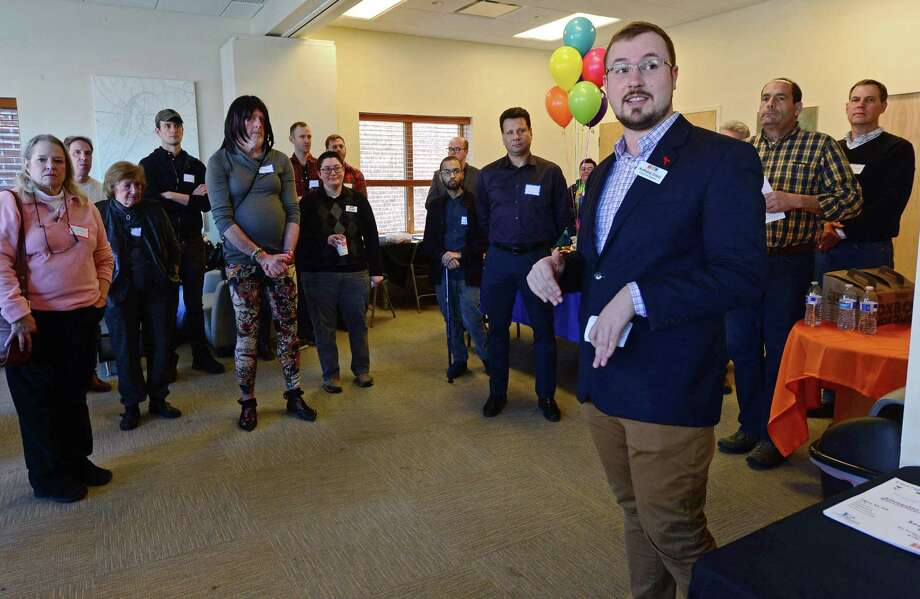Triangle Community Center president Anthony Crisci welcomes guests as the Circle Care Center, The Triangle Community Center and the Mid-Fairfield AIDS Project (MFAP) open their doors Saturday afternoon, March 4, 2017, for tours of the building, conversations about their services and announcements of their new initiatives during an open house and day of empowerment for the local LGBTQ community at their facilty located at 618 West Ave. in Norwalk, Conn. Photo: Erik Trautmann / Hearst Connecticut Media / Norwalk Hour