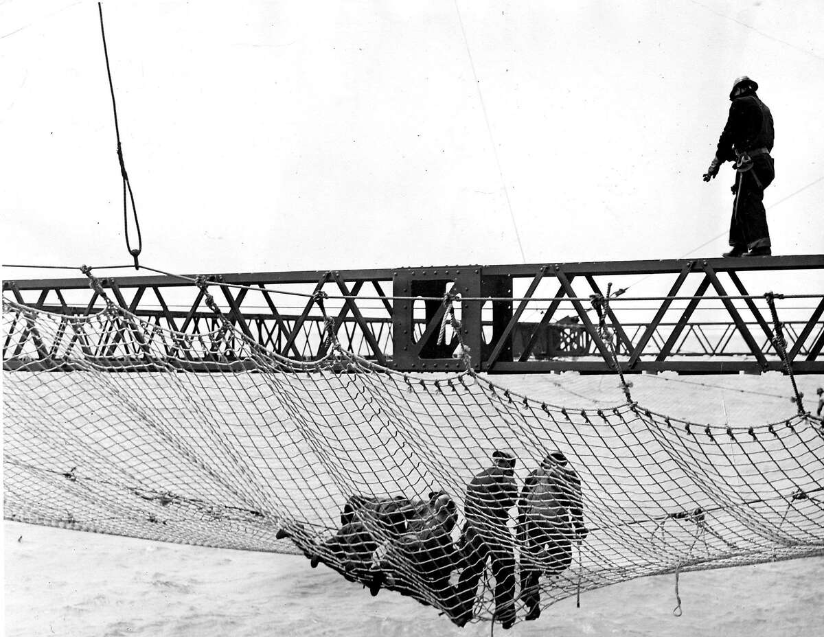 They were workers who fell off the structure while working but had their lives saved by a giant net strung up beneath the span.