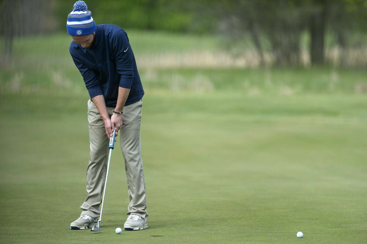 Midland High's Nevada Walters putts on the seventeenth hole during the Wednesday Saginaw Valley League golf jamboree at Currie Golf Course.