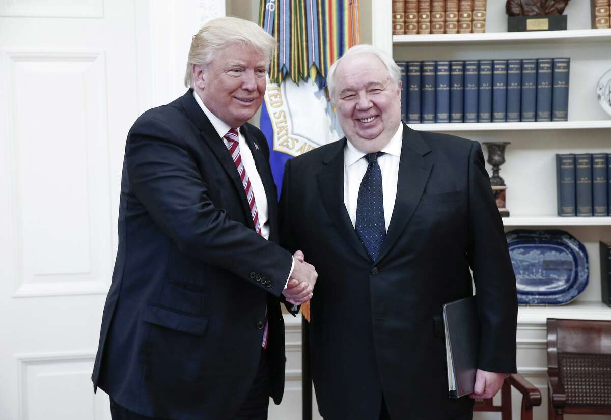 US President Donald Trump (L) shakes hands with Russian Ambassador to the United States Sergei Kislyak during talks with Russia's Foreign Minister Sergei Lavrov (not in picture) in the Oval Office at the White House.