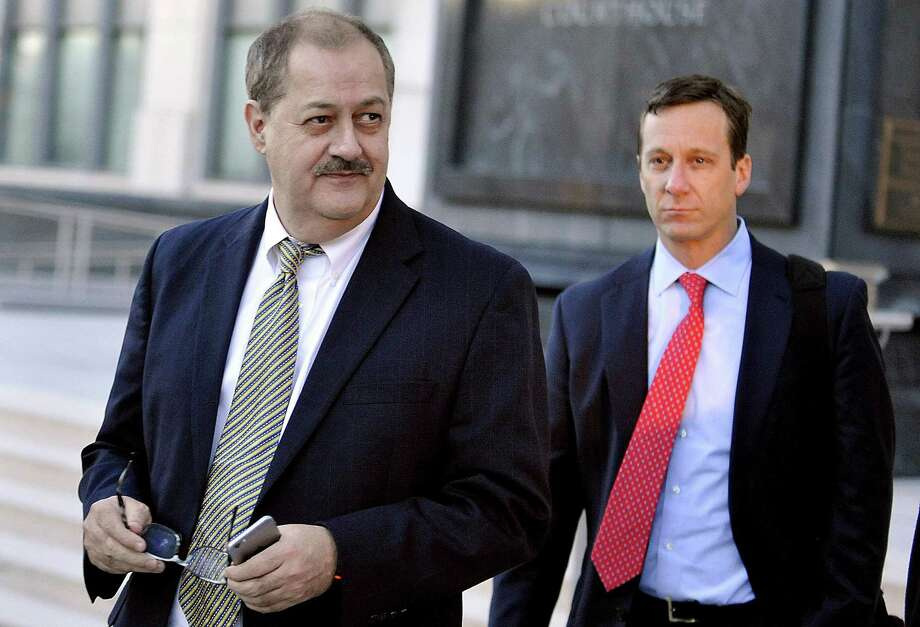 Massey Energy CEO Don Blankenship (left) was sentenced last year for a misdemeanor conviction of conspiring to violate federal mine safety standards at Massey's Upper Big Branch Mine in southern West Virginia, where 29 workers died in a 2010 explosion. Photo: Associated Press File Photo / FR171192 AP