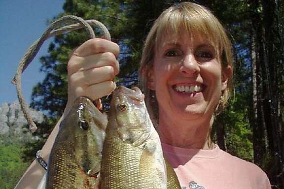 Ellen McKenna, who won fishing trip with Tom Stienstra in a Chronicle contest, with five-bass limit from Shasta Lake