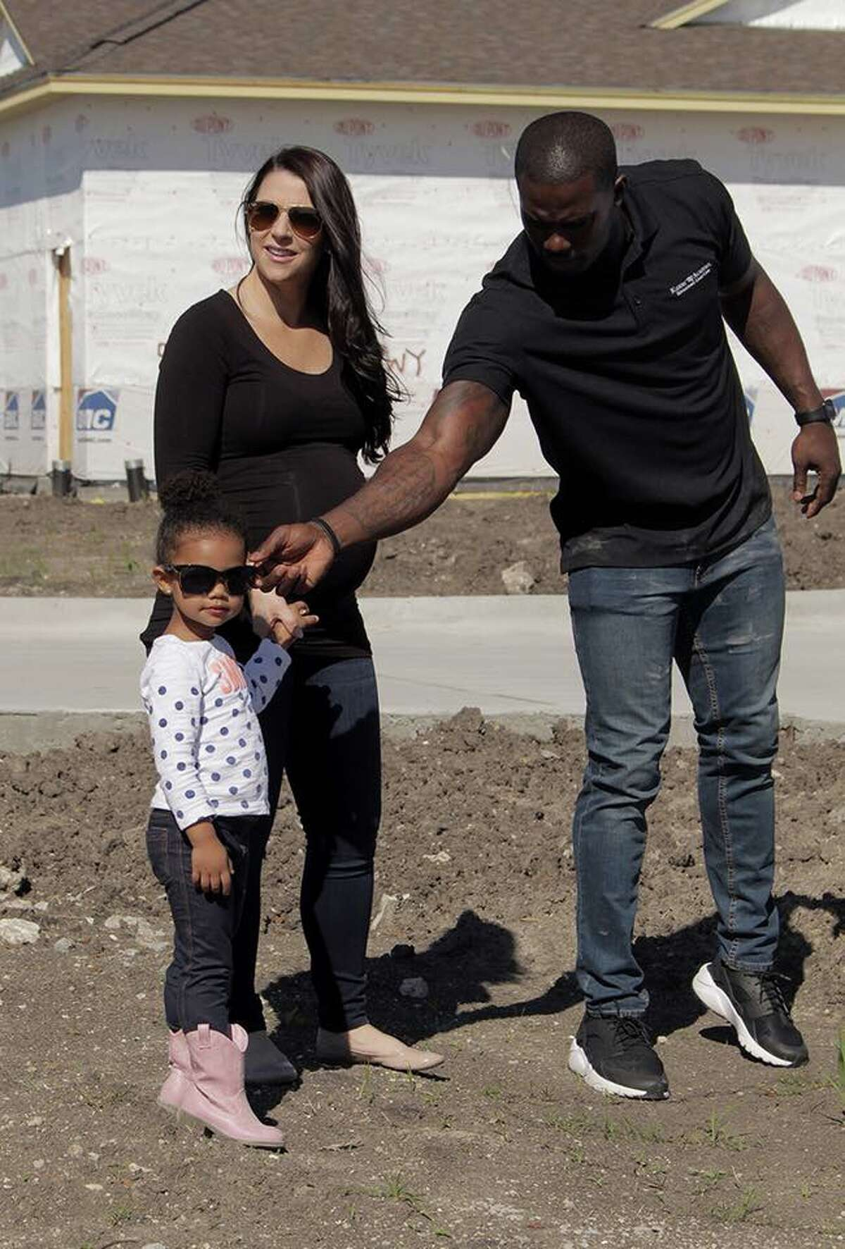James Ihedigbo and his wife, Brittany Ihedigbo, with their 3-year-old daughter, Grace. Grace will attend the center once it opens in June.