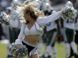 Raiderettes perform during a break in the first half as the Oakland Raiders played the New York Jets at O.co Coliseum in Oakland, Calif., on Sunday, November 1, 2015.