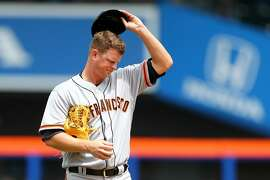 NEW YORK, NEW YORK - MAY 10:  Matt Cain #18 of the San Francisco Giants reacts in the first inning against the New York Mets at Citi Field on May 10, 2017 in the Flushing neighborhood of the Queens borough of New York City.  (Photo by Mike Stobe/Getty Images)