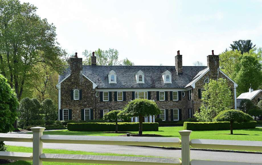 The home of General Electric CEO Jeff Immelt and wife Andrea at 705 West Road in New Canaan. As of May 2017, the house was under contract to be sold, with the Immelts having listed the property at just over $4.7 million. Photo: Alexander Soule / Hearst Connecticut Media / Stamford Advocate