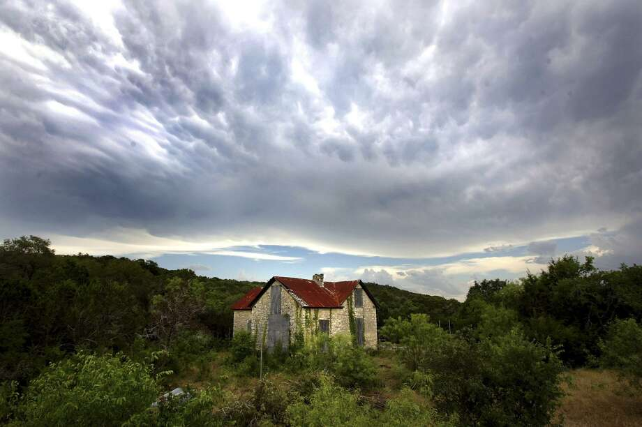 The historic Zizelmann House is seen at Government Canyon State Natural Area July 14, 2005, before the opening of the park. Photo: William Luther /San Antonio Express-News / SAN ANTONIO EXPRESS-NEWS