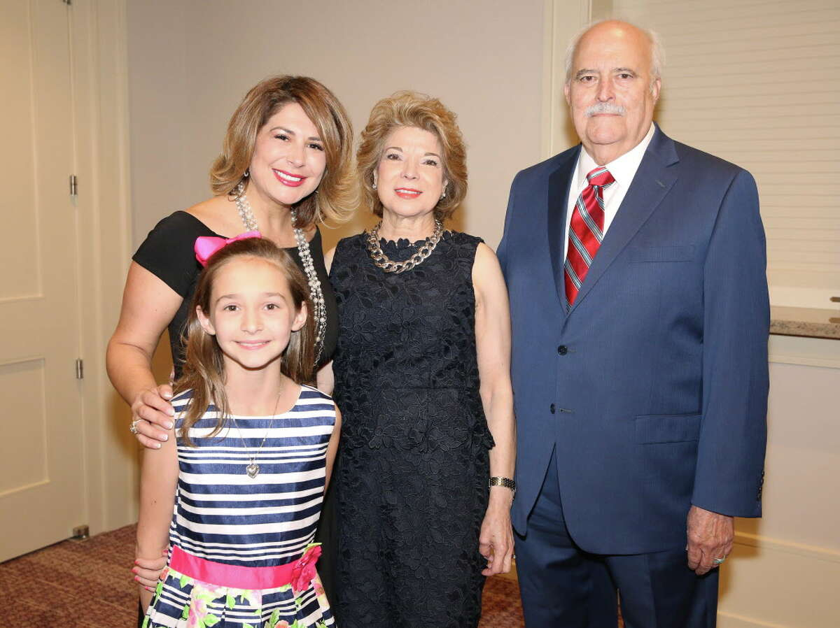 Family Houston luncheon honoree Paz Guerra, second right, poses for a photo with her family at The Briar Club Wednesday, May 10, 2017, in Houston. From left, Guerra's daughter Larissa Guerra, granddaughter Abigail Hall and husband Joe.