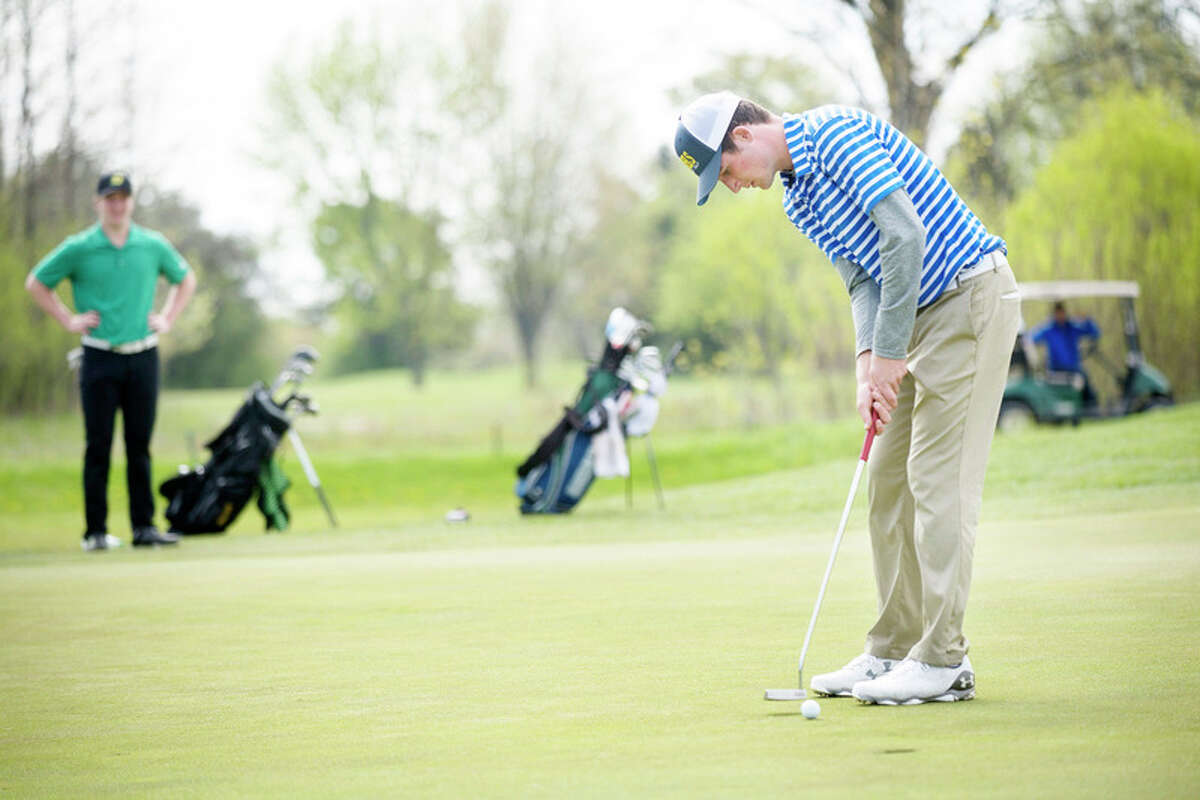 BRITTNEY LOHMILLER | blohmiller@mdn.net Midland High's Drew Gandy putts on the seventeenth hole during the Wednesday Saginaw Valley League golf jamboree at Currie Golf Course.