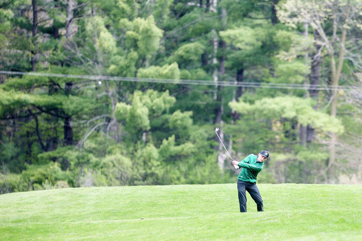 BRITTNEY LOHMILLER | blohmiller@mdn.net Dow High's Joey Johnson tees off from the seventeenth tee box during the Wednesday Saginaw Valley League golf jamboree at Currie Golf Course.