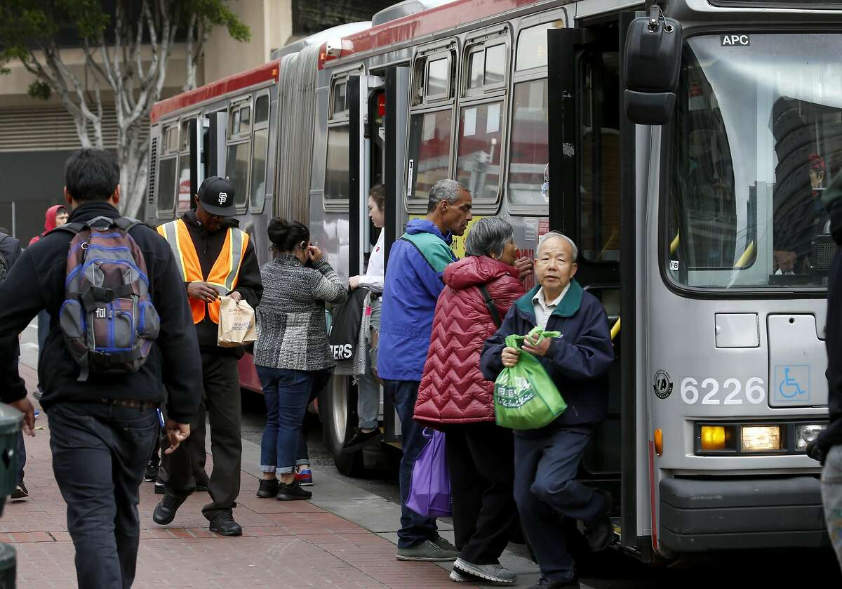 Passengers hop on and off a Muni bus at Cyril Magnin and Market streets in San Francisco, Calif. on Wednesday, May 10, 2017.
