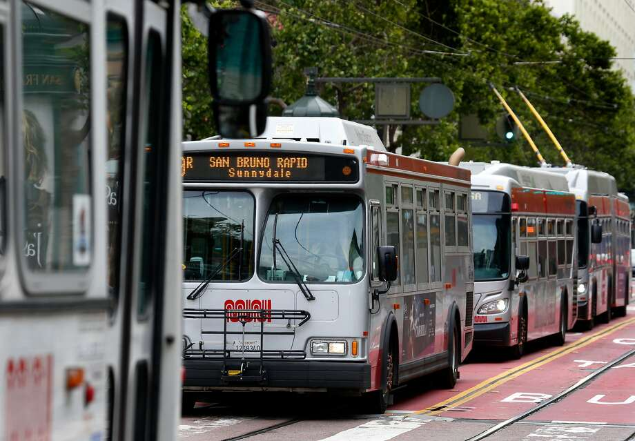 Muni drivers cope with all kinds of chaos aboard their buses, but they say erratic operators of Uber and Lyft cars make their jobs much tougher. Photo: Paul Chinn, The Chronicle