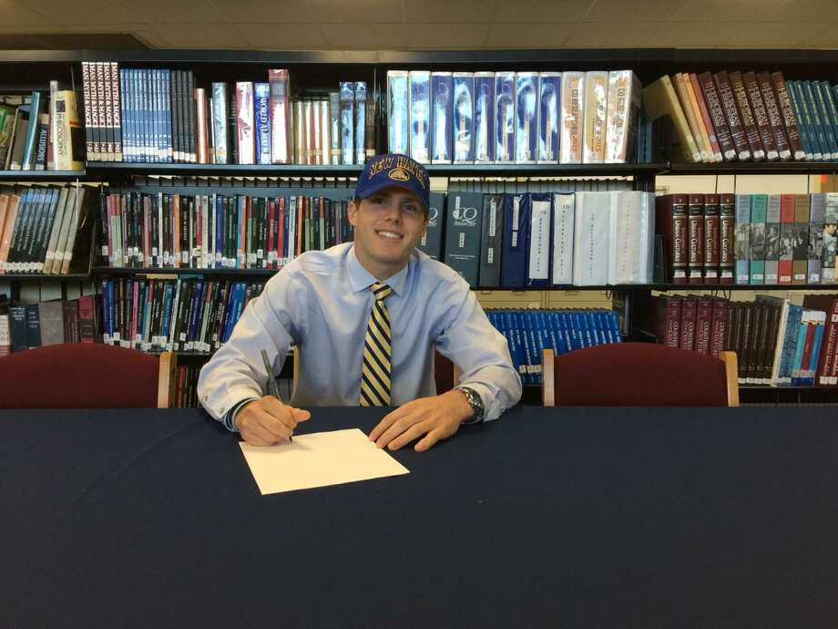 Foran's Brett Huber signs his National Letter of Intent to play football at the University of New Haven. Photo: Contributed Photo