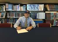 Foran's Brett Huber signs his National Letter of Intent to play football at the University of New Haven.