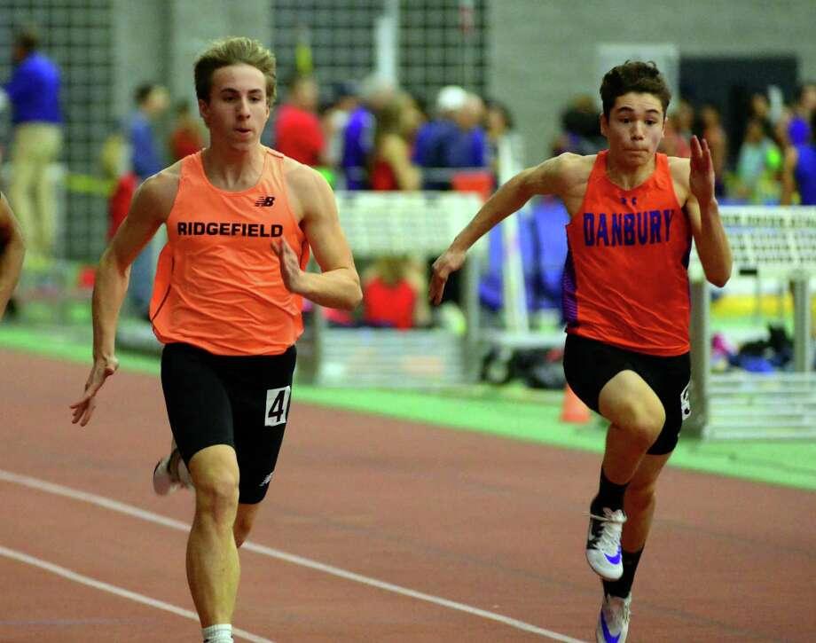 Ridgefield's Aidan Spearman, left, is a Hearst Connecticut Media boys indoor track and field all-star. Photo: Christian Abraham / Hearst Connecticut Media / Connecticut Post