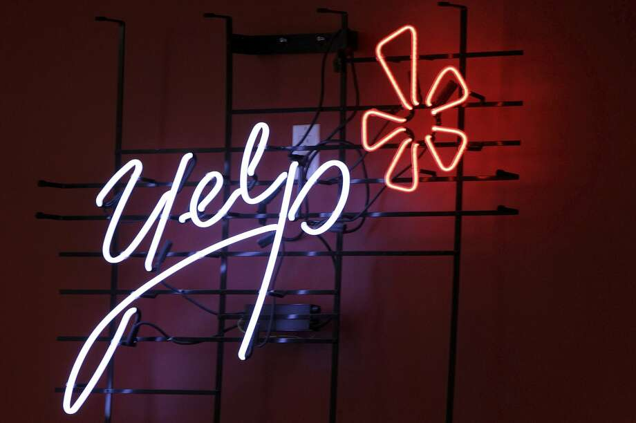 Yelp Inc., the site that lets users review everything from diners to dentists, is set to rehire 1,100 employees furloughed in April. Photo: Kathy Willens, Associated Press