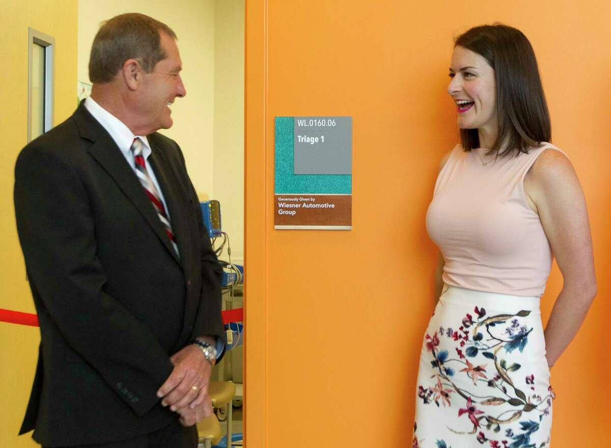 Don Wiesner and his daughter Falon Wiesner-Jones with Wiesner Buick GMC are seen outside a emergency room triage room donated by the Wiesner family at Texas Children's Hospital The Woodlands, Wednesday, May 10, 2017, in Conroe.