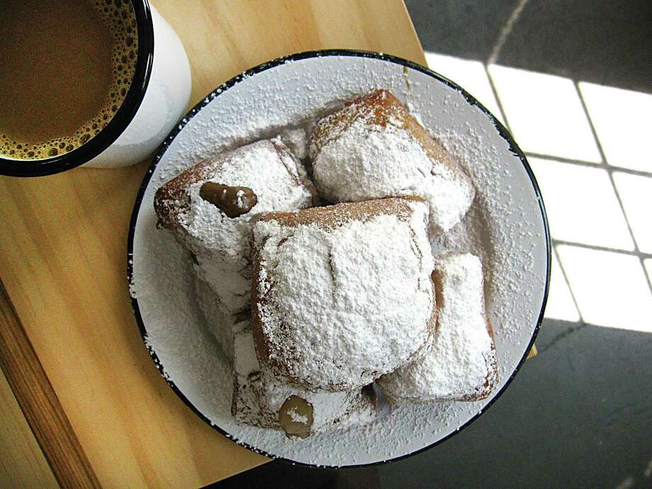 Beignets and cafe au lait from NOLA Brunch & Beignets. Photo: Mike Sutter /San Antonio Express-News