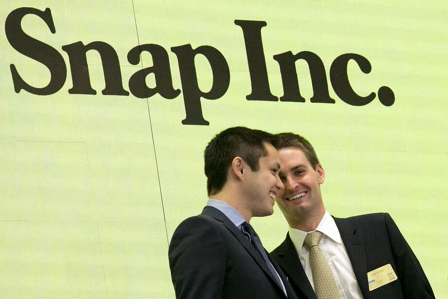Snapchat co-founders Bobby Murphy, left, and CEO Evan Spiegel ring the opening bell at the New York Stock Exchange as the company launched its IPO on March 2, 2017.The celebration ended on Thursday because of a model's tweet.  Photo: Richard Drew, Associated Press