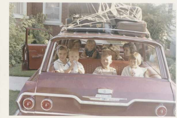 The Ward siblings packed into the family station wagon for a long road trip.