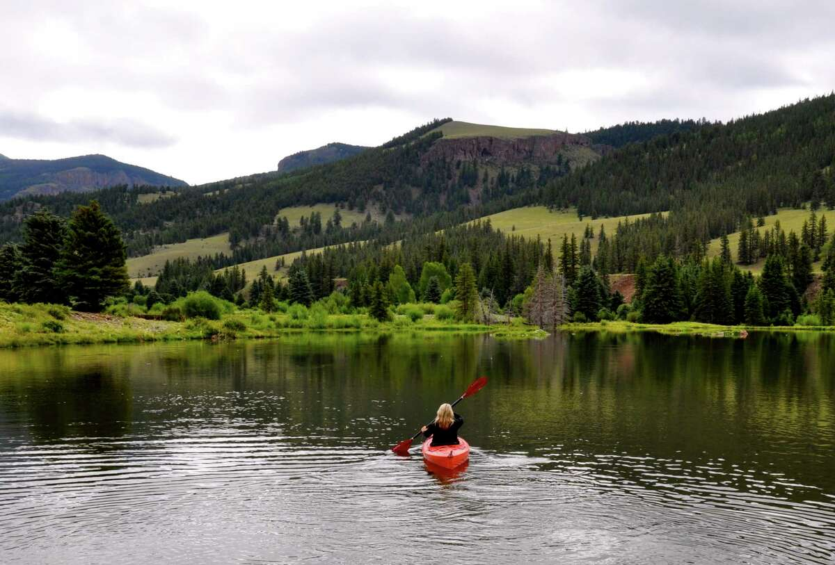Melissa Aguilar paddles a pond near Creede, Colo.