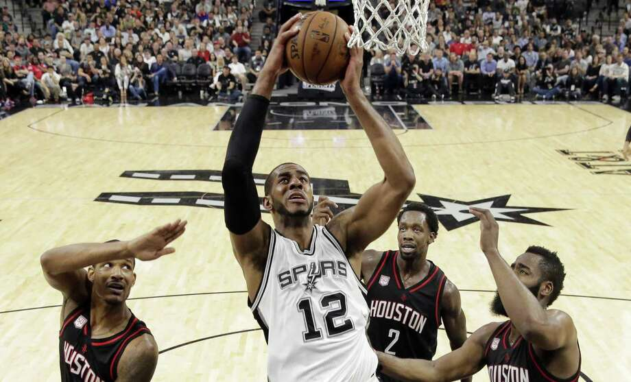 Spurs forward LaMarcus Aldridge goes up for a shot between Rockets defenders Trevor Ariza (1), Patrick Beverley (2) and James Harden (13) during the first half of Game 5 on May 9, 2017, in San Antonio. Photo: Eric Gay /Associated Press / Copyright 2017 The Associated Press. All rights reserved.
