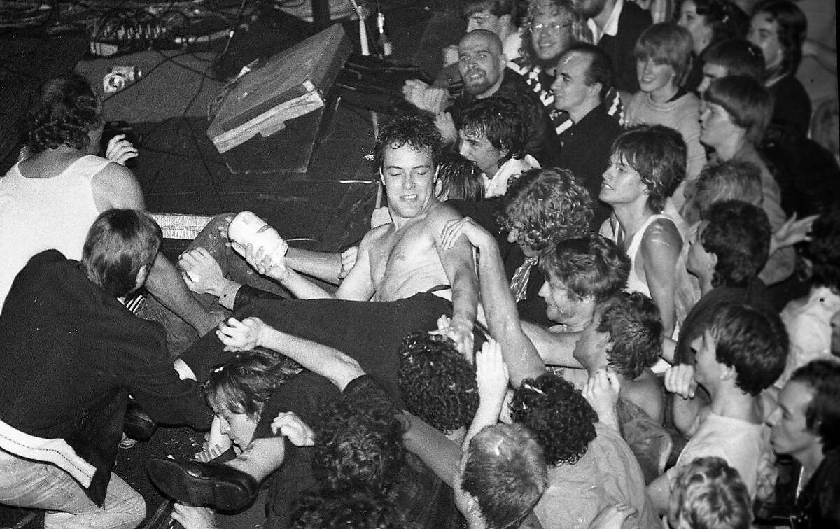 The San Francisco Punk music scene, with photos taken at many venues including Temple Beautiful, the Deaf Club and Mabuhay Gardens , October 16, 1979 Here Jello Biafra has leaped into the crowd.
