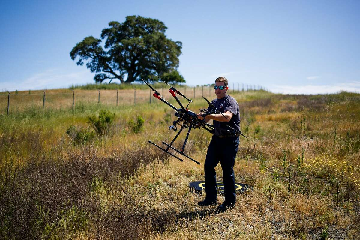 Kevin White of the Menlo Park Fire Protection District retrieves the drone during a search and rescue training at SLAC National Accelerator Laboratory in Menlo Park, Calif. Friday, May 5, 2017.