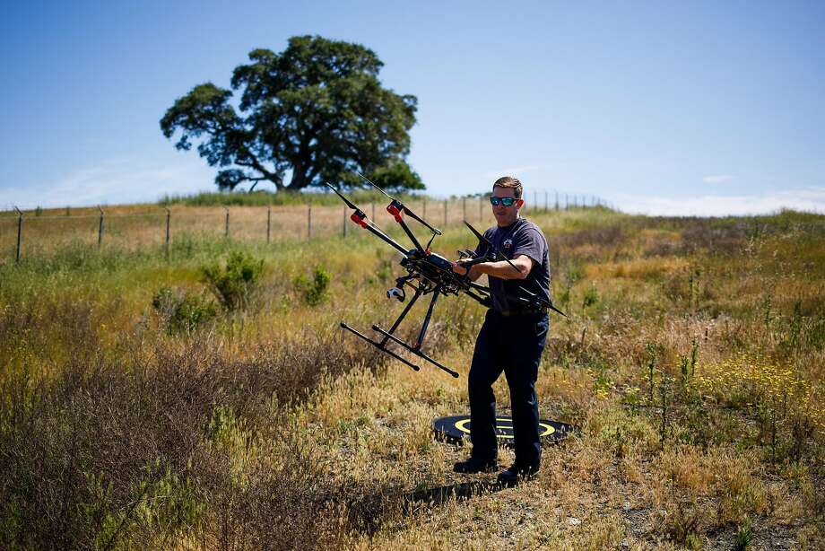 Kevin White of the Menlo Park Fire Protection District retrieves the drone during a search-and-rescue training at SLAC National Accelerator Laboratory in Menlo Park. Photo: Mason Trinca, Special To The Chronicle