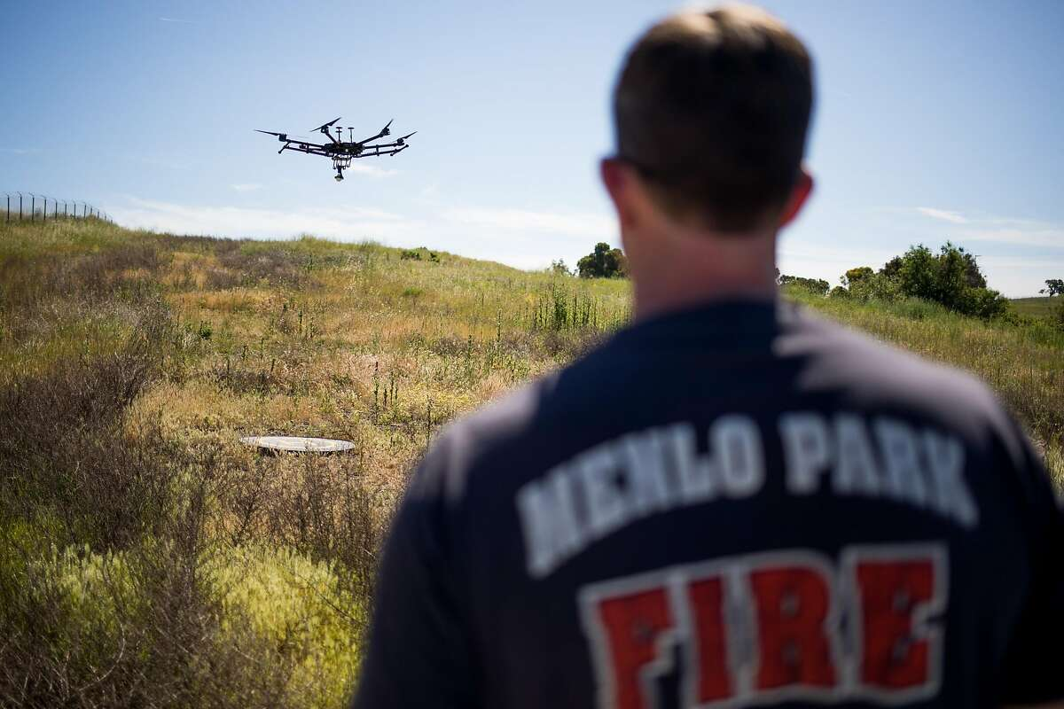 Kevin White of the Menlo Park Fire Protection District prepares to land the drone during a search and rescue training at SLAC National Accelerator Laboratory in Menlo Park, Calif. Friday, May 5, 2017.