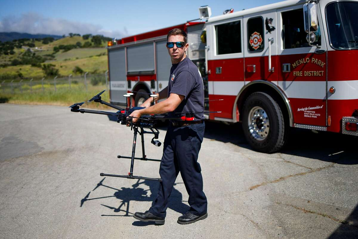 Kevin White of the Menlo Park Fire Protection District prepares to deploy their drone during a search and rescue training at SLAC National Accelerator Laboratory in Menlo Park, Calif. Friday, May 5, 2017.