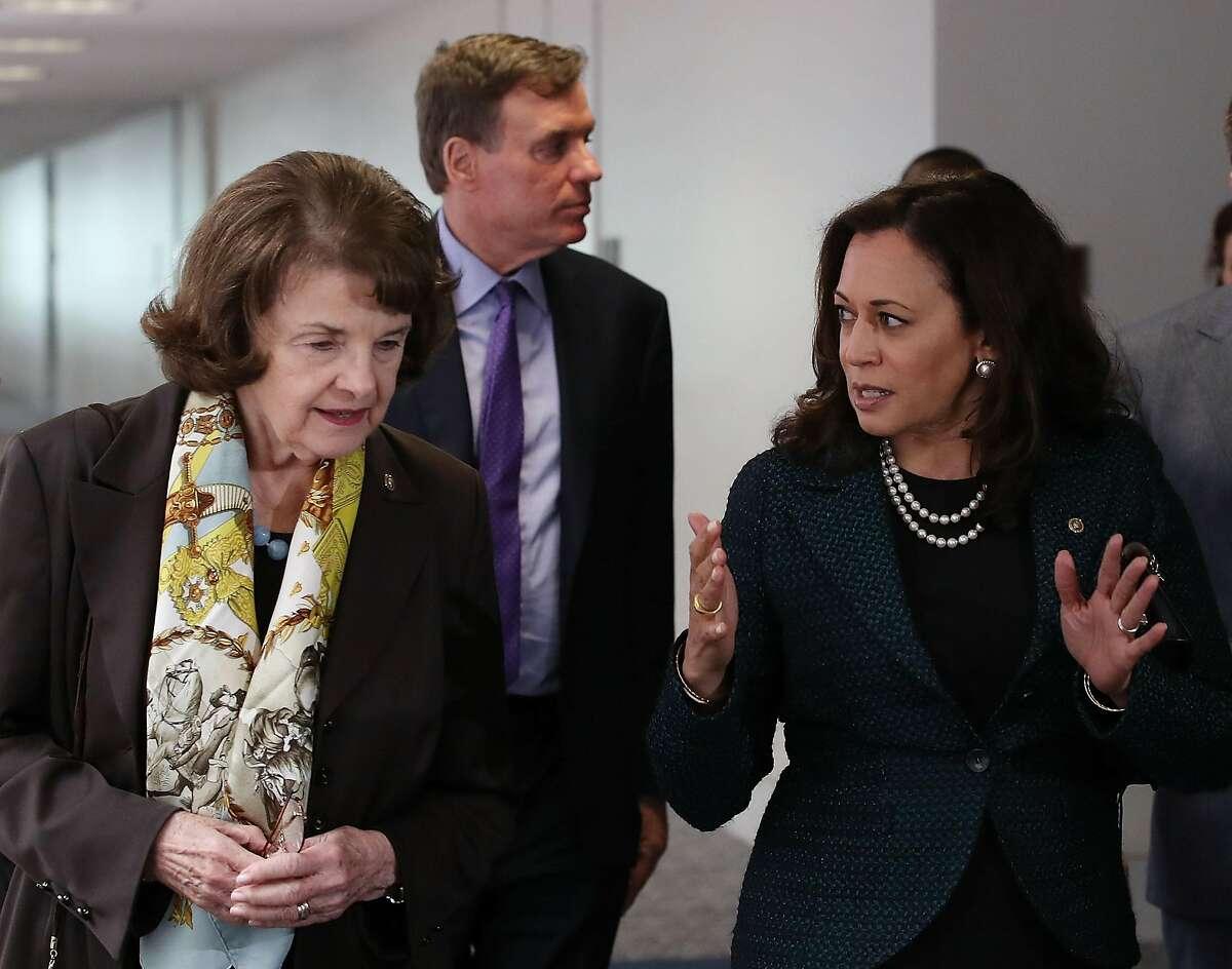 WASHINGTON, DC - APRIL 27: Sen. Dianne Feinstein (D-CA)(L) walks with Sen. Kamala Harris (D-CA) and Sen. Mark Warner (D-VA) (C), to a Senate Select Committee on Intelligence closed door meeting at the U.S. Capitol, on April 27, 2017 in Washington, DC. Th